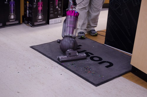 Dyson Animal Complete vacuum working on confetti