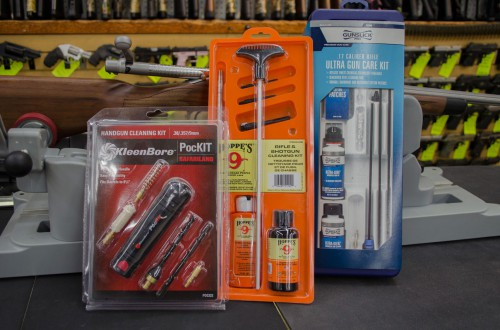 Eric picked out some kits - these are just a few of the dozen or so gun cleaning kits we have here in the store. The small one is a universal handgun cleaning kit.