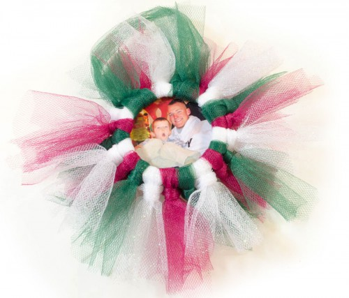Red, white, and green tulle adorn this Tulle Wreath Photo Frame ornament!