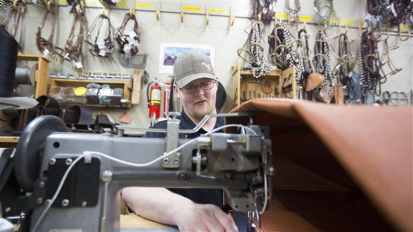 Tom making pack bags here in our workshop (photo by Briana Scroggins, Standard-Examiner)