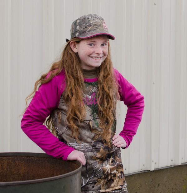 Emileigh loves this pink-sleeved girls' Carhartt camo shirt!