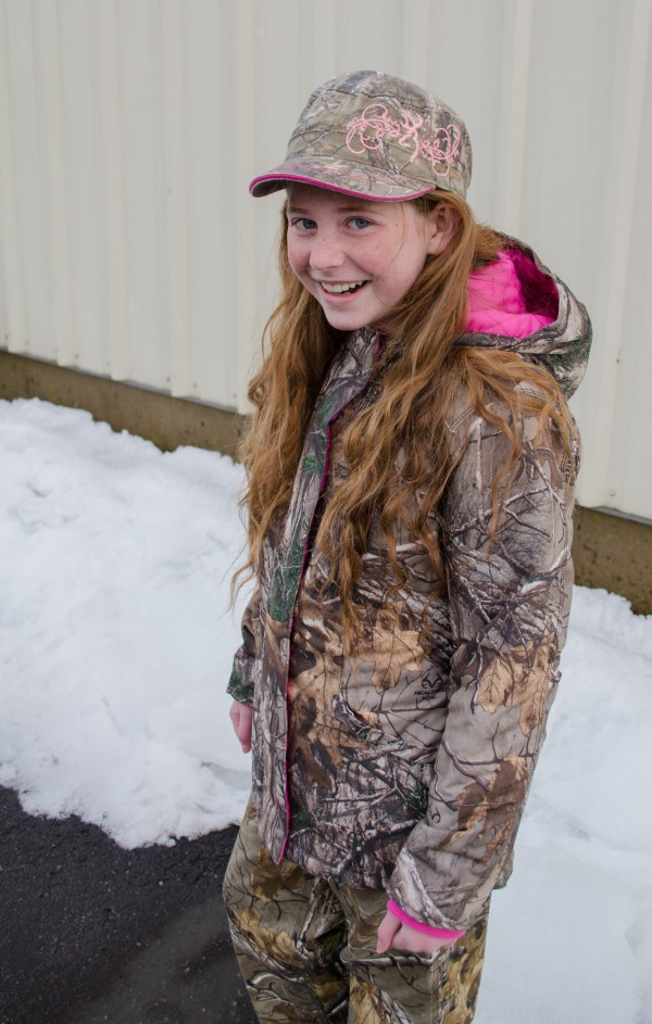 Emileigh wearing girls' camo jacket with pink hood and Browning camo hat