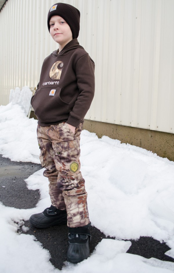 Sam with boys' camo pants and Carhartt brown hoodie