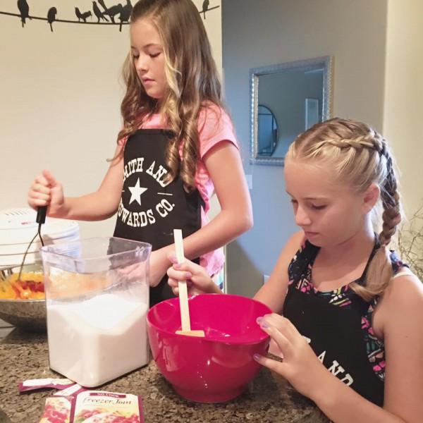 Making apricot freezer jam: adding sugar and lemon juice