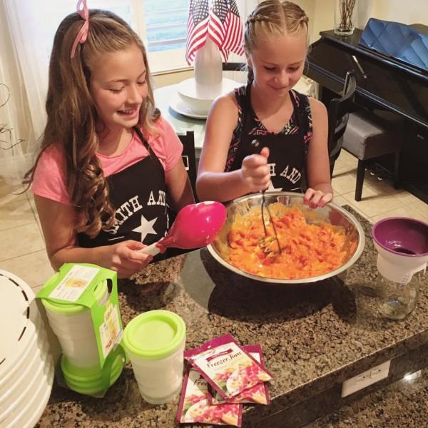 Making apricot freezer jam: mashing the apricots
