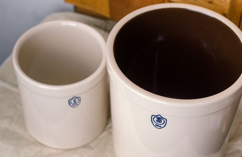 This one gallon pickling crock has a natural interior, while the three gallon crock has a chocolate-brown interior