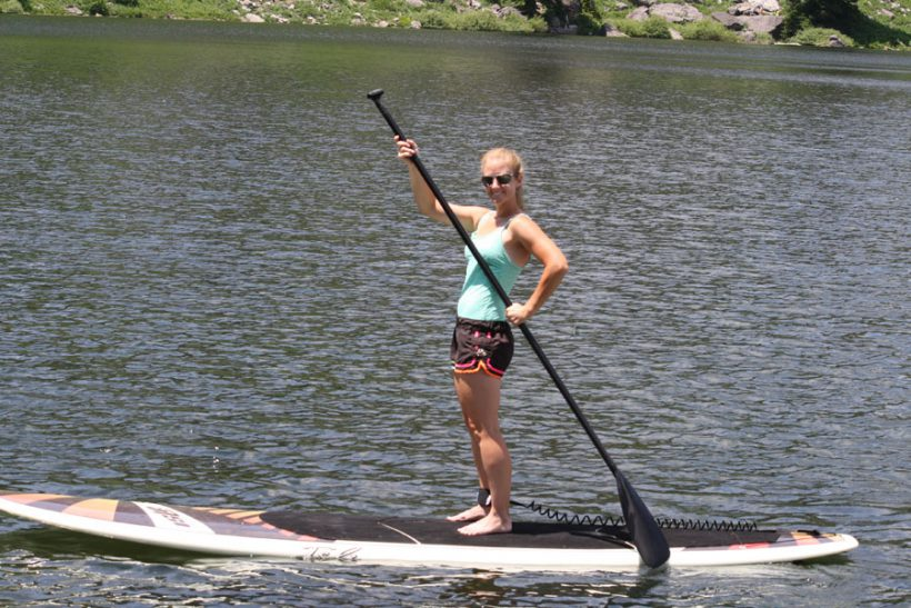 Merrill's daughter paddleboarding
