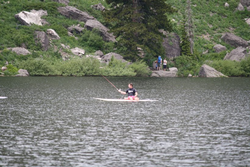 Merrill fishing from his paddleboard