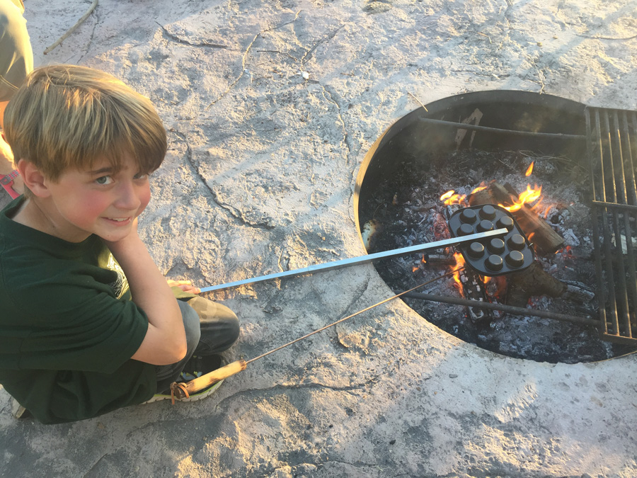 Making doughies on a fire pit