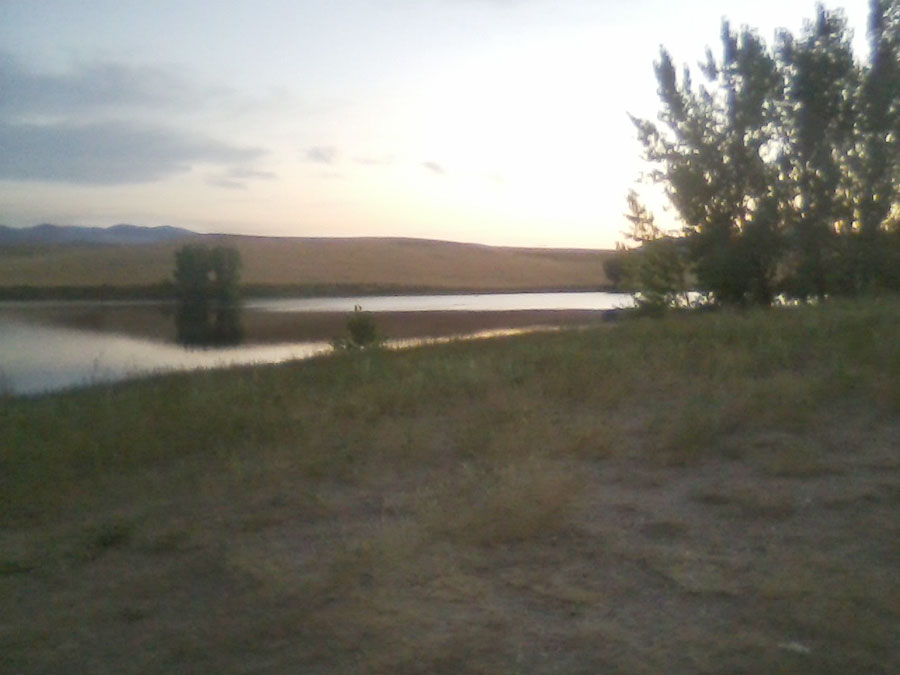 Lake shore at sunset in Idaho where Travis went fishing