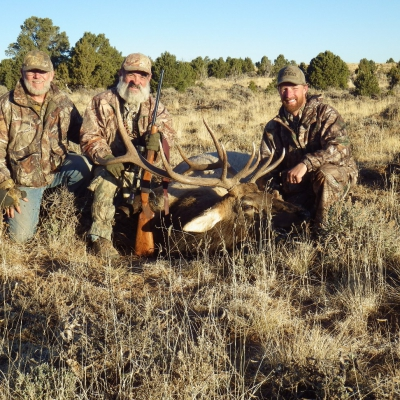 Louis Zundel, center, and a 6x6 Bull Elk